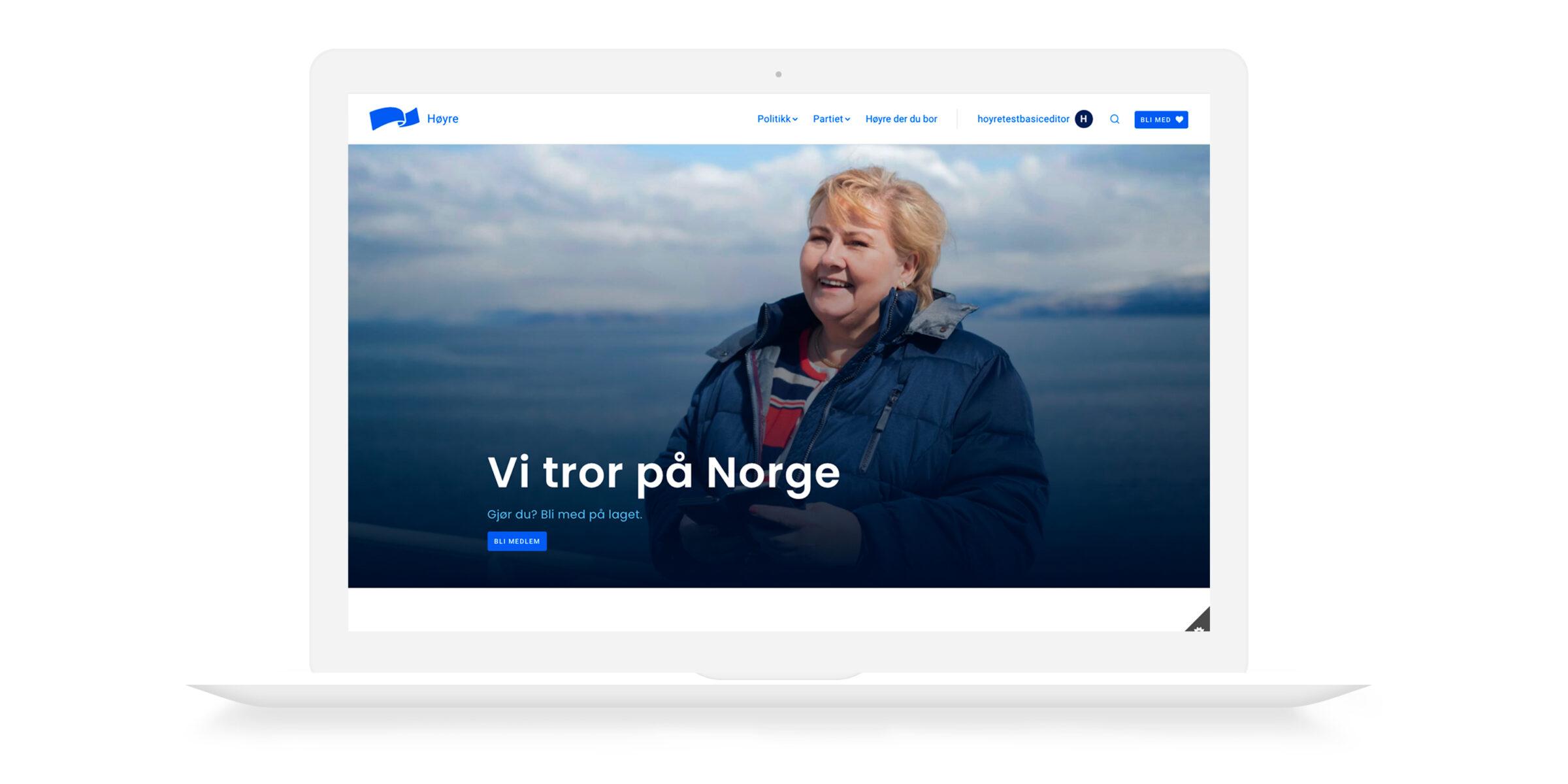 Mac med skjermbildet fra høyre sin nettside, der det er bilde av Erna og testen
