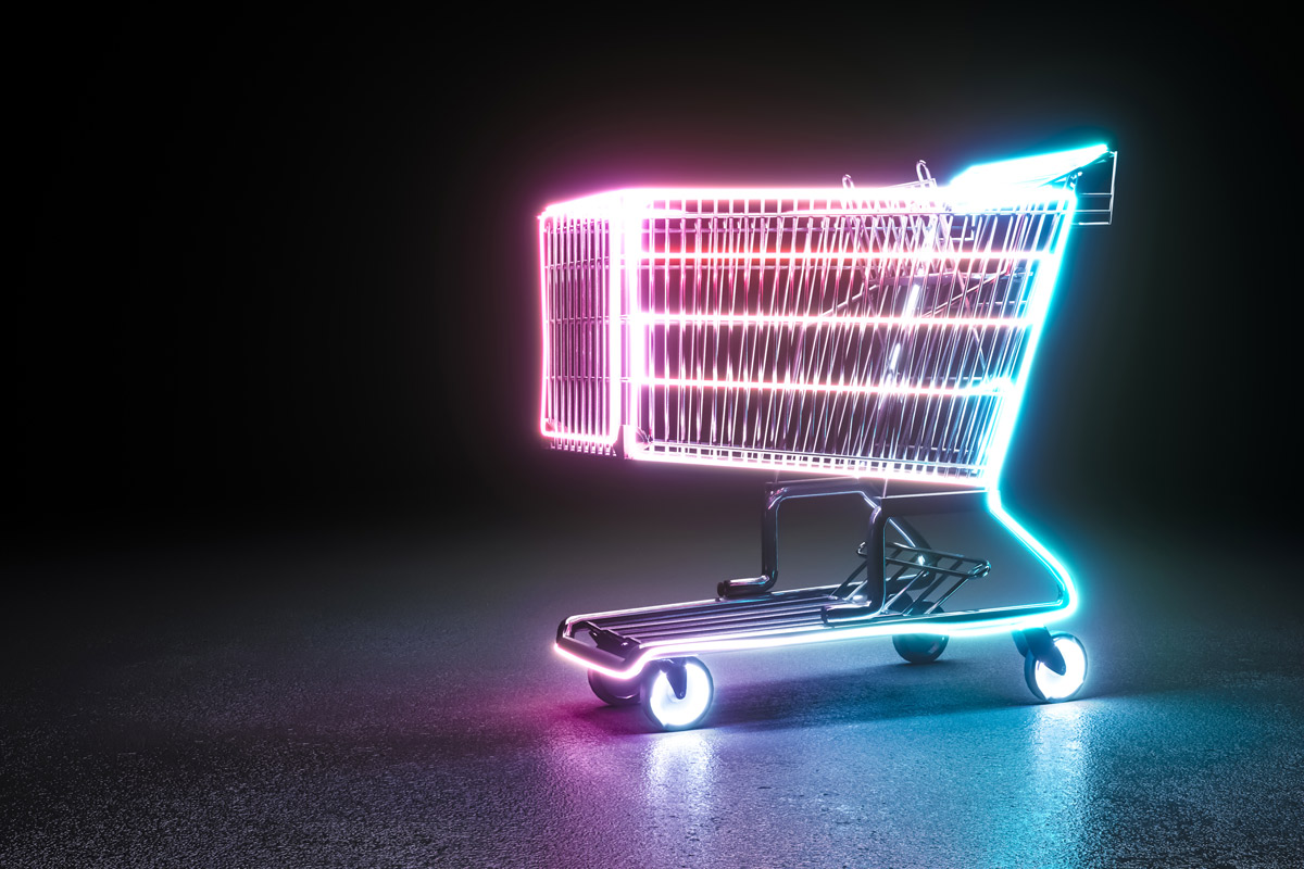Handlekurv med neonfarger som lyser i mørket. Symbol på den digitale netthandelen.